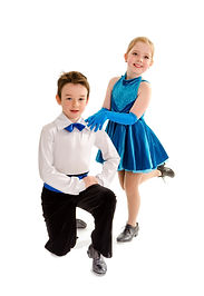 A Young Boy and Girl Tap Dance Partners