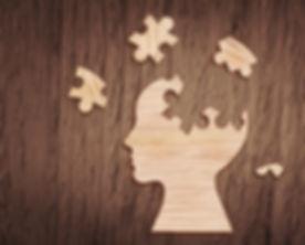 Human head silhouette with a jigsaw piec