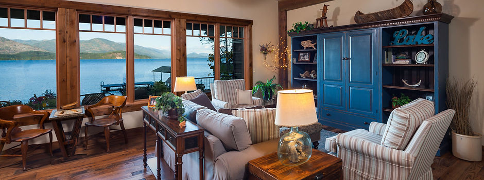 Lakefront home with large windows.