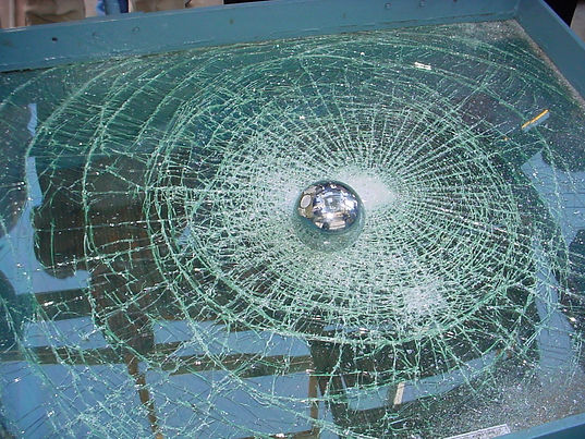 A shattered window protected by safety film.