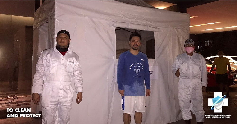 Senator Manny Pacquiao standing infront of an ISPS Sanitization Unit CB-19