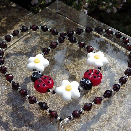 Lampwork ladybird and daisy garnet neckl