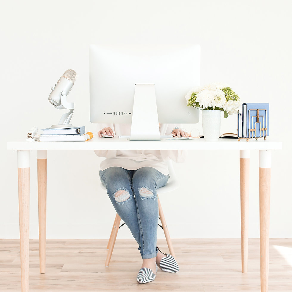 Female Business Coach Working on Compute