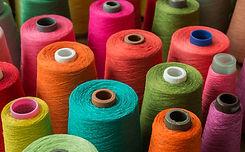 Colorful yarn on spool, yarn on tube, co