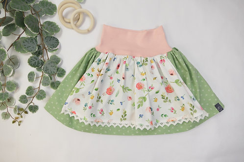 """Dirndlrock """"grün mit Frühlingsblumen"""" (Bündchenfarbe: Pfirsich-rosa)"""