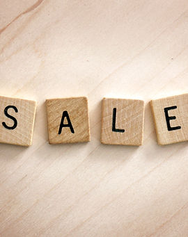 The Words Sale are spelled out in wooden