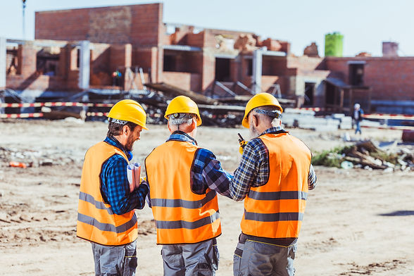 three-workers-in-hardhats-and-reflective