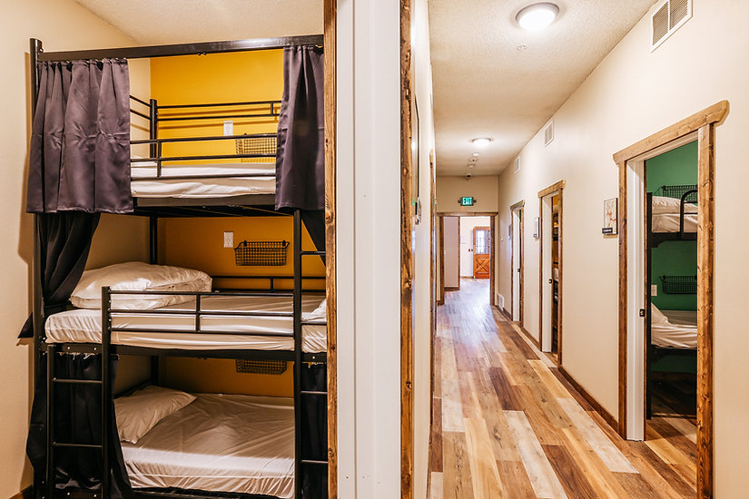 Hostel bunk beds with curtains