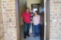 Family opening door