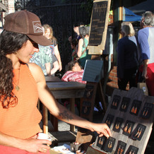 Local jeweler selling her work at street fair