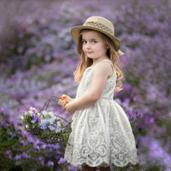 Child in purple flower field