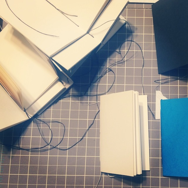 Finishing a mountain of sketchbooks for the Banknote Wallet Kickstarter