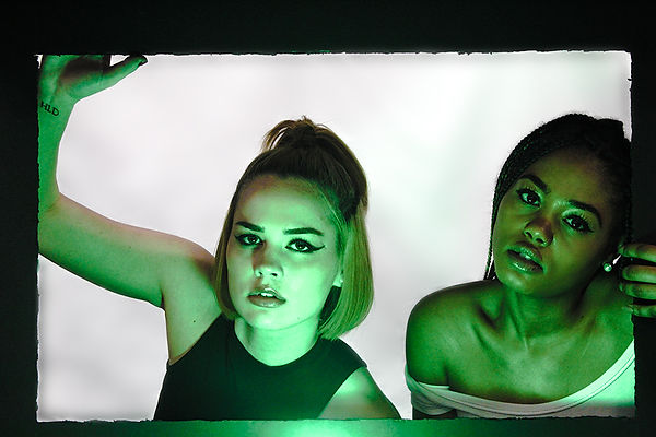 Two female models posing in frame with neon lighting beauty shot by MXJ Photography