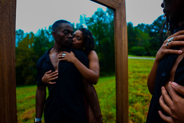 Black couples shoot in open field with mirror shot by MXJ Photography