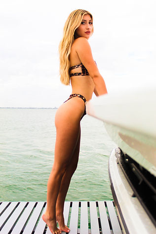 Love Island's Lakeyn for MaDE fashion editorial located on a yacht in Miami Florida shot by MXJ Photography
