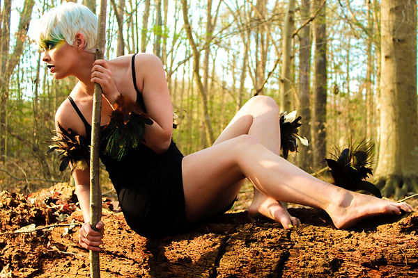 Female model shot in editorial fashion as a bird in the woods shot by MXJ Photography