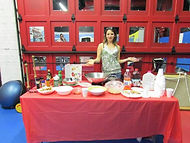 Kara Williamson doing great cooking demo with healthy alternative foods on the go.jpg