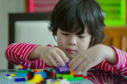 Little boy playing bricks.Asian child ho