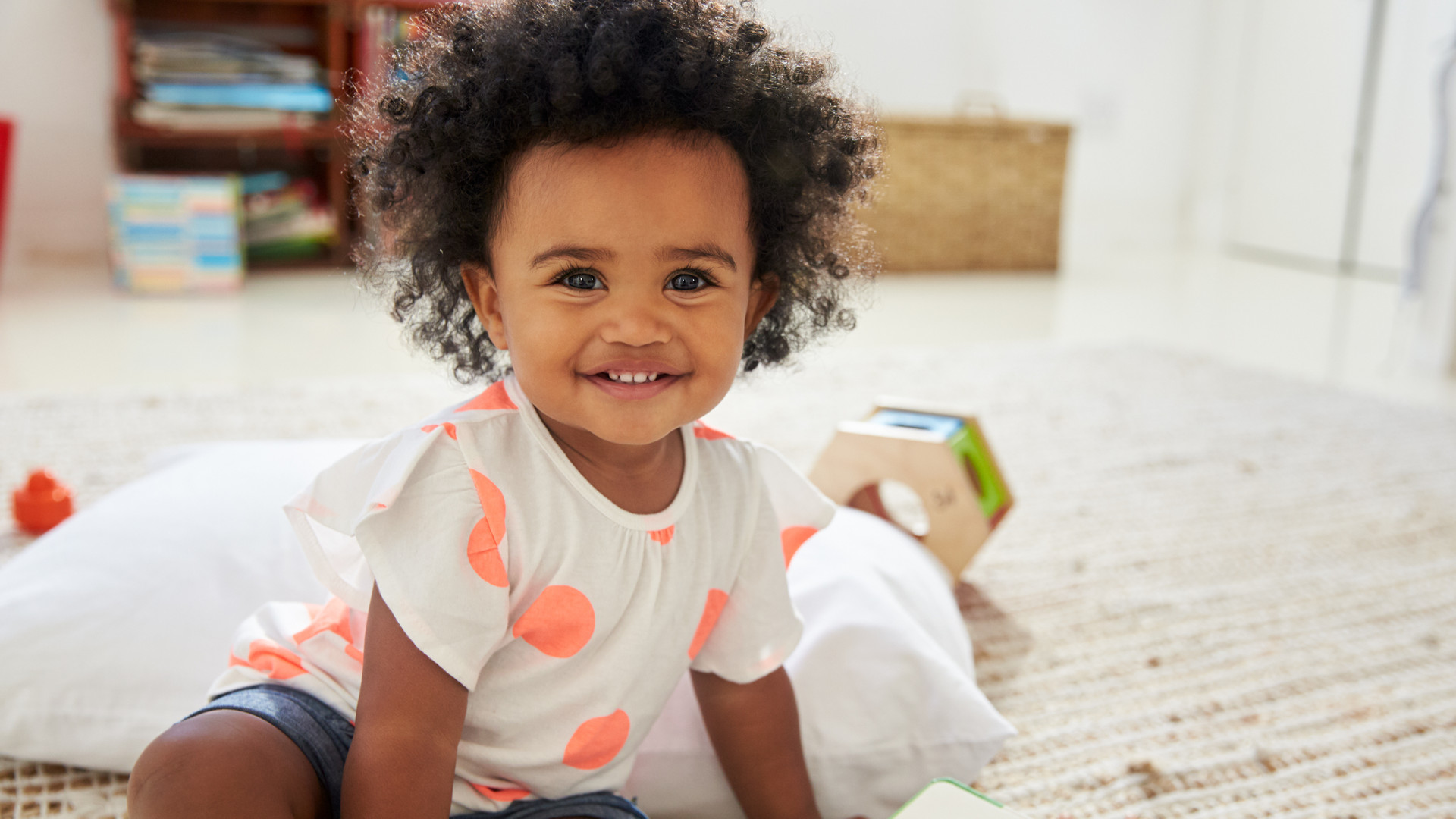 Portrait Of Happy Baby Girl Playing With