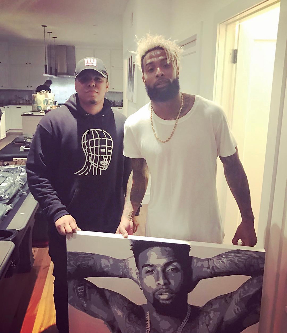 @youngDex presents @OBj aka Odell Beckham Jr with a hand painted masterpiece.