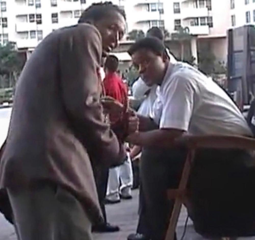 Will Smith & Jalen James Acosta on the set of 'ALI'. 2001.