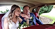 Beautiful Couple on their wedding day drinking champagne in a Rolls Royce Silver Cloud Wedding Car