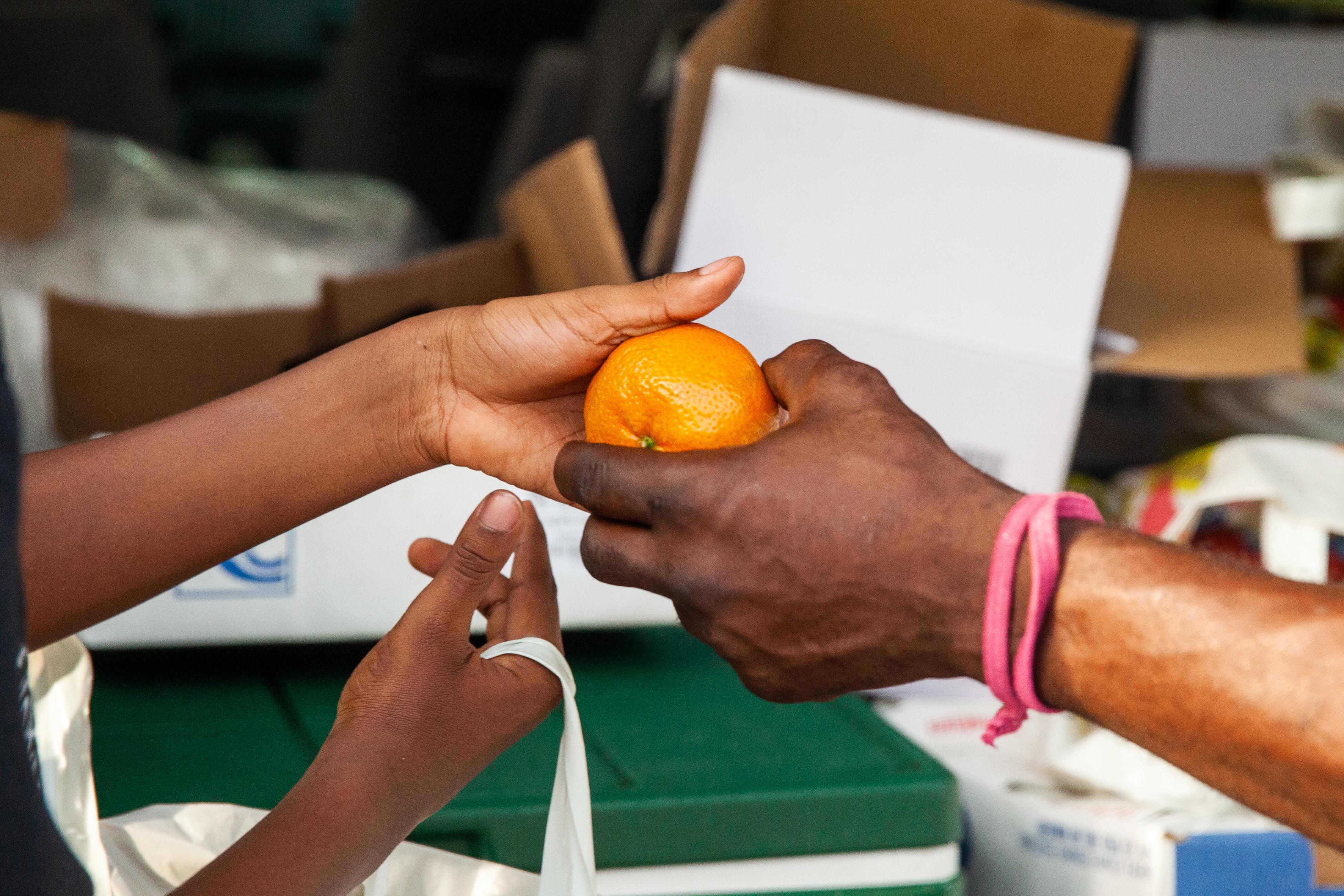Kenyan Handing Man A Tangerine.jpg