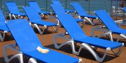 A sock lounging an a sun chair on a cruise