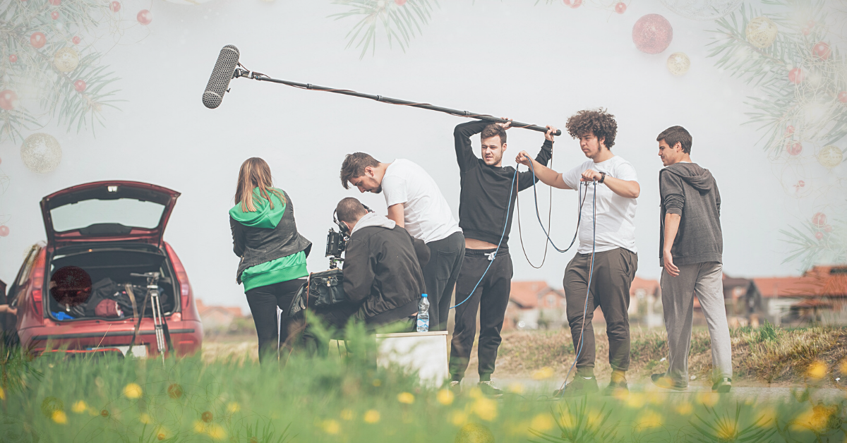 Film Crew standing outside with gear