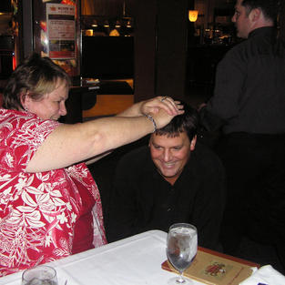 Susy Gaffney blesses a magician at an AU