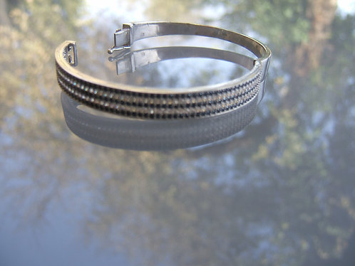 Silver bracelet with tiny black & white inlay Zircons