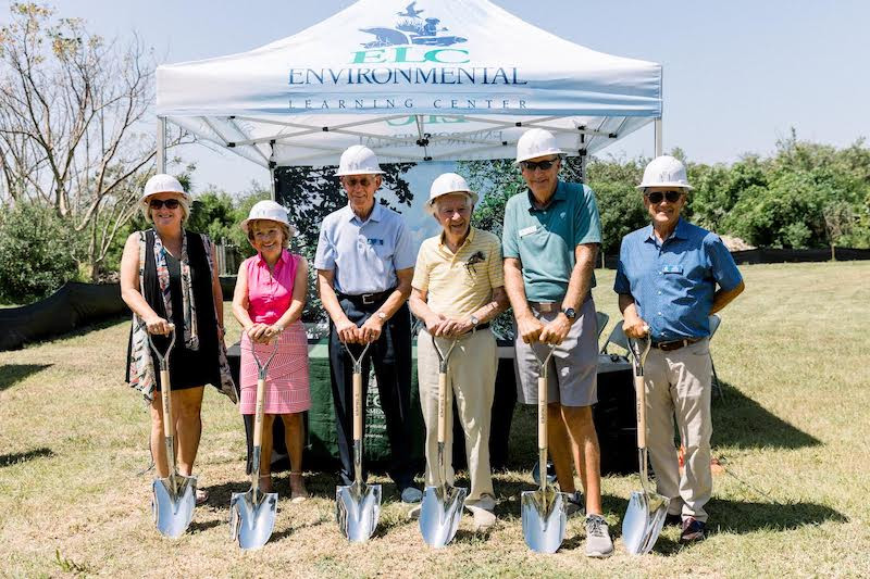 people with shovels and hard hats at groundbreaking ceremony