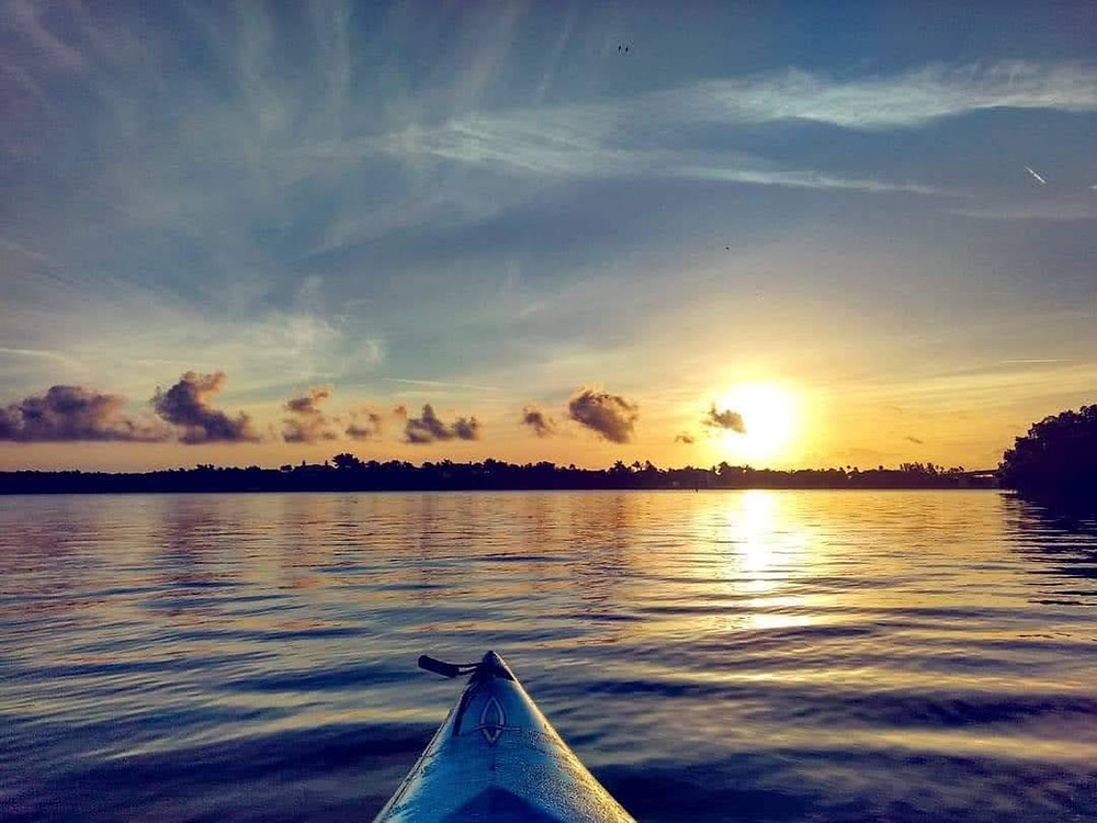 tip of canoe on Indian River Lagoon at sunset