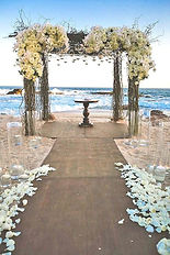 Seaside Soirees and Weddings Beach Ceremony Arch Aisle Ocean