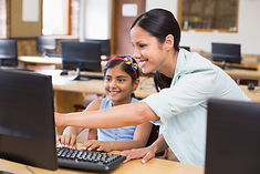 cute-pupil-computer-class-with-teacher.j
