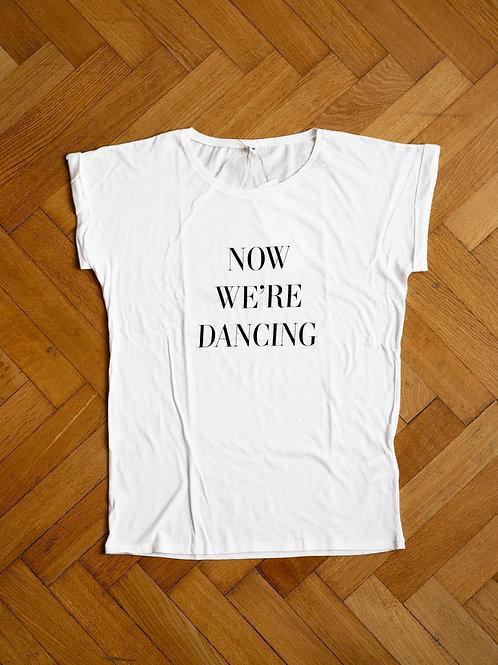 NOW WE'RE DANCING