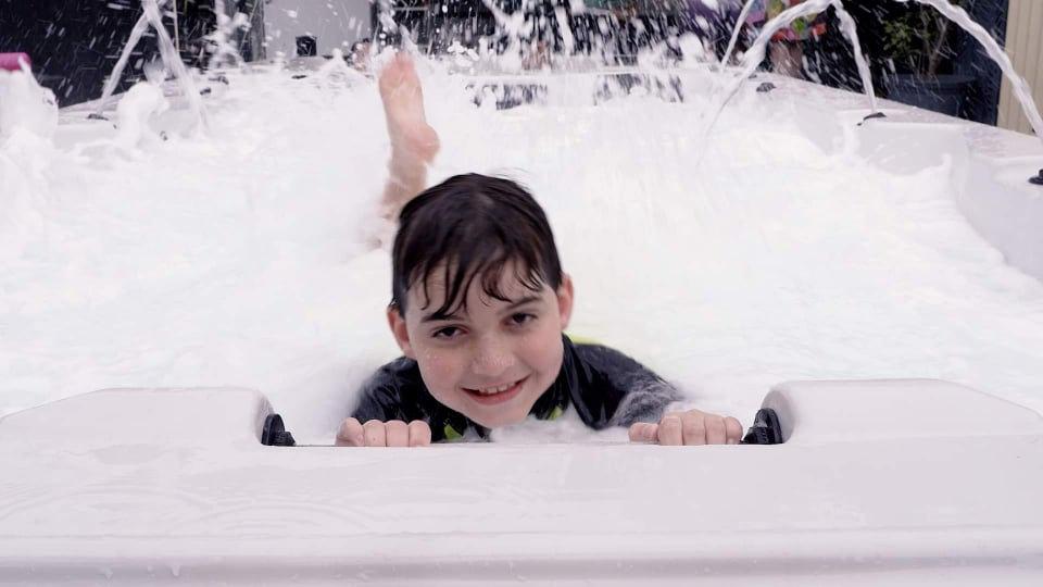 Kid in Swim Spa.jpg