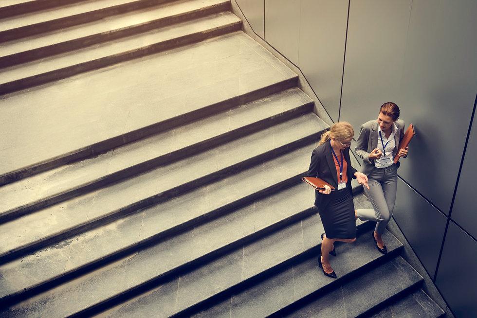 businesswoman-corporate-colleagues-talki