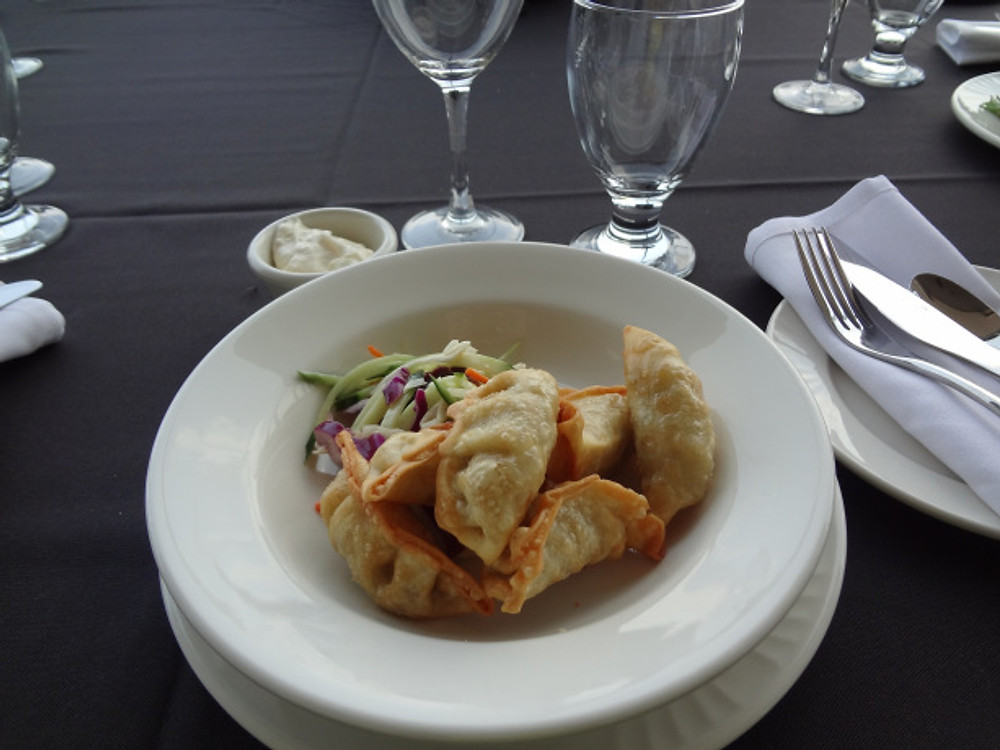 Crispy Beef Dumpling with cucumber carrot slaw and horseradish dipping sauce