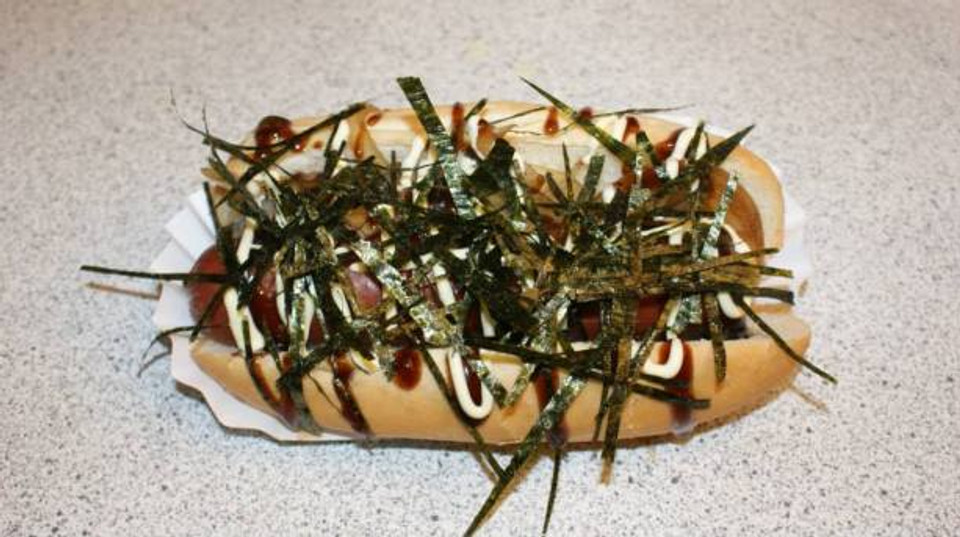 Japanese Hot Dog - The classic hot dog gets a tasty Japanese facelift. An Angus Beef hot dog is topped with perfectly sautéed onions, teriyaki sauce, japanese cream sauce, Japanese Nori (Japanese Seaweed) and a hint of wasabi mayo to bring you the juicy delectable Japanese Hot Dog.