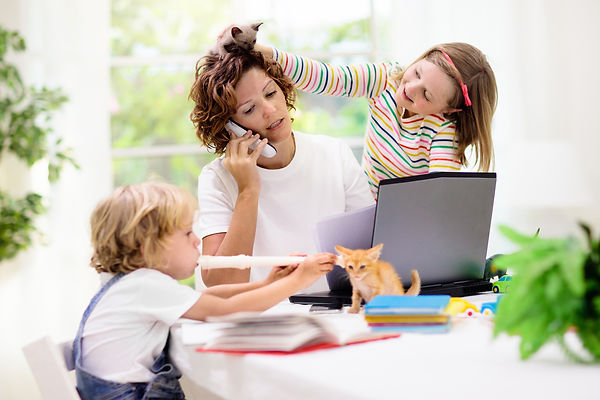 Mother working from home with kids. Quar
