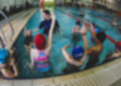 Dean Kent teaching children backstroke
