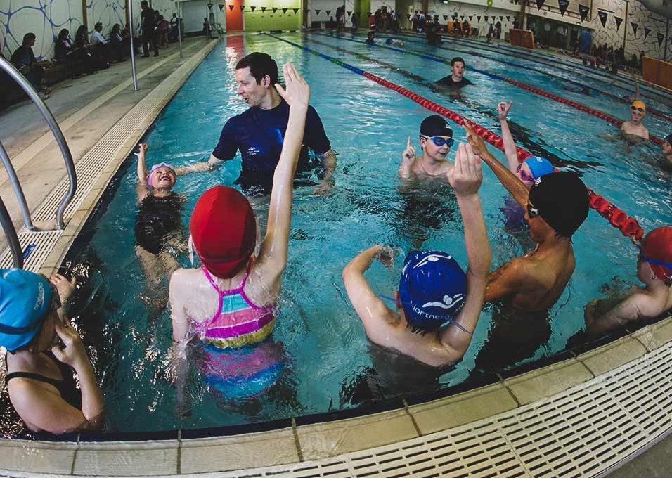 Dean Kent teaching children backstroke