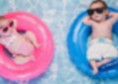 Babies floating in pool rings