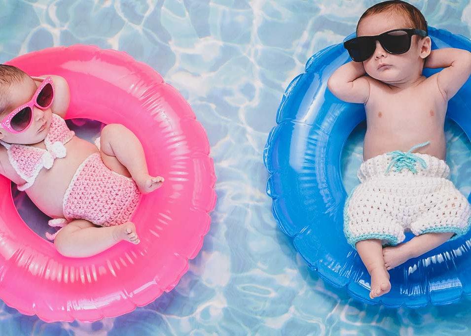 Babies floating in pool rings