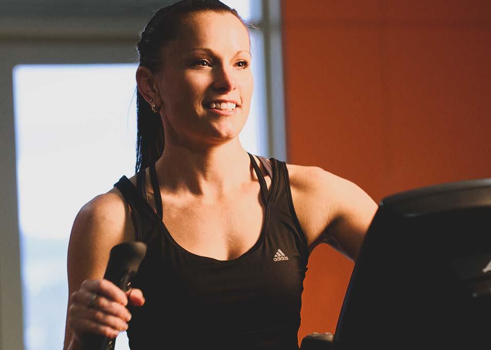 girl on cross trainer smiling