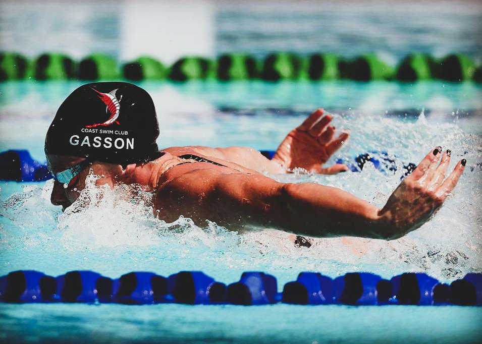 Helena Gasson swimming butterfly for Coast Swim Club