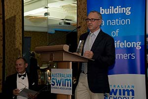 Director of Swimming Mark Saunders accepting the Swim School award in Cairns, Australia