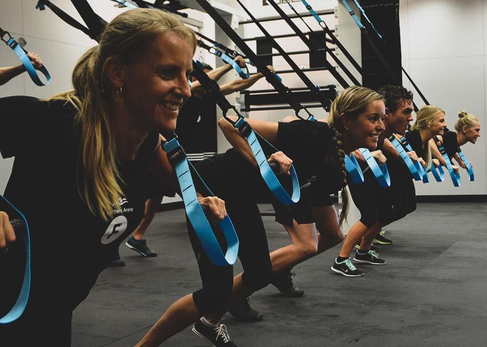Group using TRX straps to do push ups