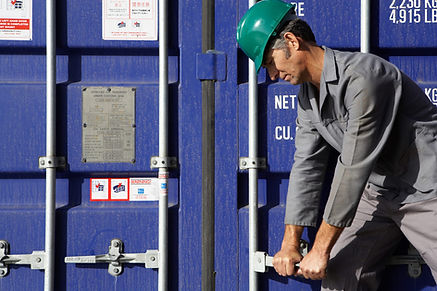 Photo of port worker with container